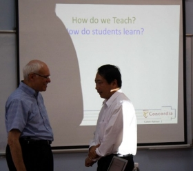 Dr. Kalman with the Rector of Tra Vin University. Presenting to 37 faculty members in Việt Nam, November-December 2010.