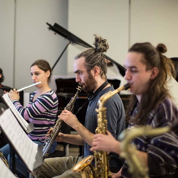 Members of the eclectic ensemble practising