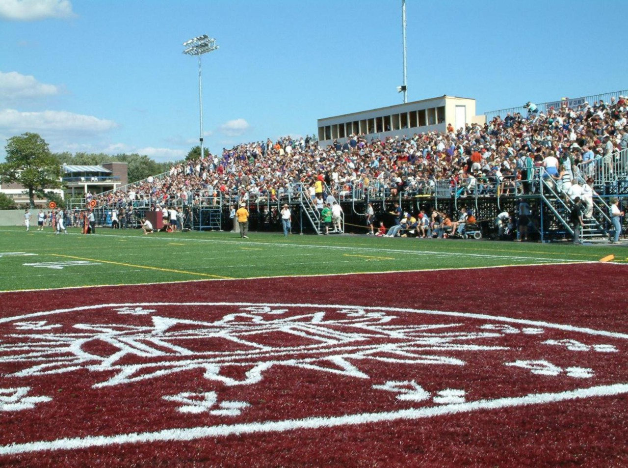 Home-opener football game and inauguration of the new field and temporary stadium