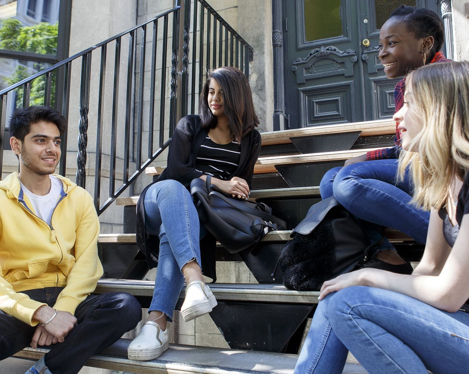 Students sitting on a stoop