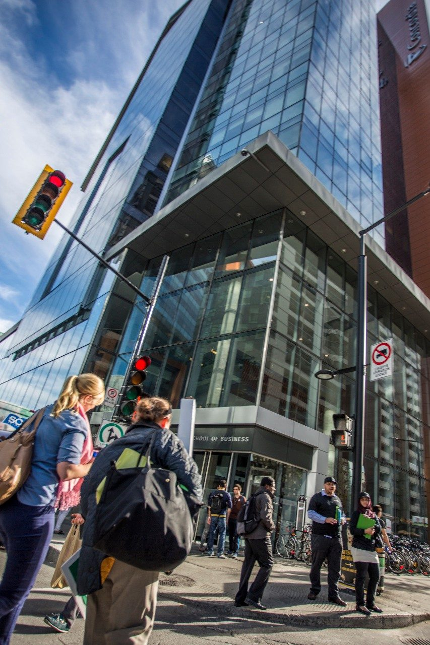 Students outside at the corner of Concordia University's John Molson School of Business building