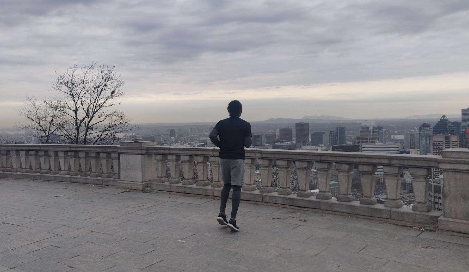 Runner standing at the top of Mount Royal