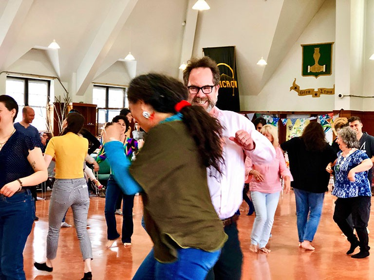 Dean of Students Andrew Woodall Participating in movement activity led by Deby Maia de Lima. Photo by Rachel Chainey