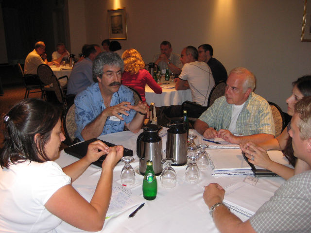 Richard Bastien (left) leads a discussion during the Quebec Institute for Lead Learners.Photo by Concordia University