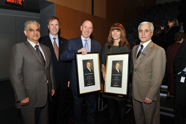 At the John Molson School of Business Awards of Distinction ceremony, held November 9 at the BMO Amphitheatre in the JMSB Building (from left to right): JMSB Dean Sanjay Sharma; Peter Kruyt, Chair of Concordia's Board of Governors; Award of Distinction recipient Randall Kelly, president of Formula Growth Ltd.; Award of Distinction recipient Anna Martini, president of Groupe Dynamite Inc.; and Joseph Capano, Principal Director of Development, JMSB. | Photo by Ryan Blau/PBL Photography.