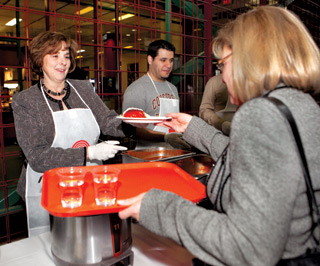 President Judith Woodsworth serves pasta at the November 25 Centraide fundraising lunch. | Photo by Concordia University