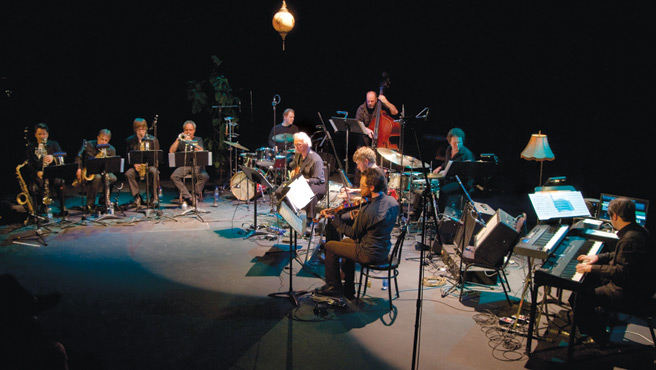 Surrounded by musicians of his choice, music professor Gary Schwartz (centre) plays Lettingo: The Music and Influence of Ornette Coleman during its first performance to a sold-out house at Montreal's Théâtre Lachapelle in January 2010. | Photo courtesy Gary Schwartz