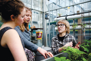 Ruby Jean Van Vliet (right) leads tours of the Henry F. Hall Building greenhouse as one of her many duties as communications officer there. She got involved through her problem-based service learning course last year. | All photos by Concordia University