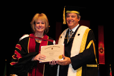 Kathy Reichs, forensic anthropologist and author, receives an honorary doctorate from Chancellor L. Jacques Ménard at this year's fall convocation. | Photo by IPI