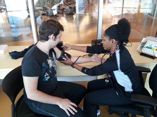 David has his blood pressure taken by PERFORM trainer Alicia Wright.