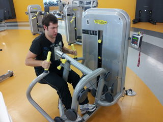 The low row machine puts David through his paces. | Photo by Sebastian Buna