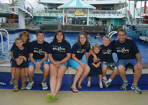 The Bergeron family display their Shuffle 22 spirit on September 16, 2011, aboard their ocean cruise: (from left) Luke, Nancy, Jonathan, Elizabeth, Sarah, Laura, Matthew and Serge.