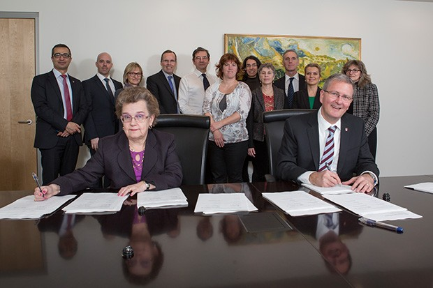 Alan Shepard, president of Concordia, and Irene Fernandez, president of CULEU, sign the CULEU collective agreement on February 25