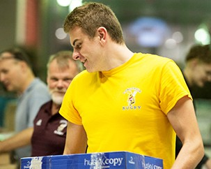 Men's rugby team — the Used Book Fair's go-to cleanup crew