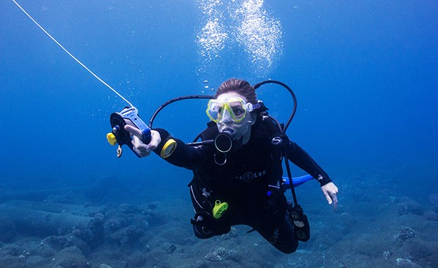 Mikayla Wujec scuba dives off the island of Molokaʻi, Kalaupapa National Historical Park, Hawaii