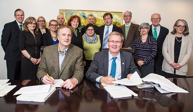 Concordia President Alan Shepard (right) and CUPFA President David Douglas sign the CUPFA collective agreement.