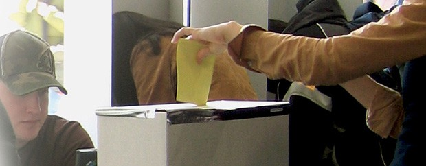 Voter using ballot box on campus