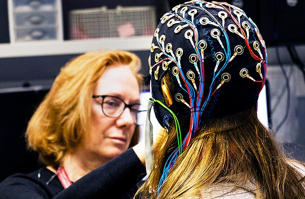 A cap embedded with electrodes allows researchers to complete an electroencephalogram test, which measures and records the electrical activity of your brain. | Photo courtesy: the PERFORM Centre Sleep Lab