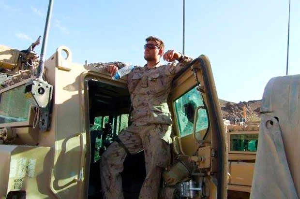 Leger takes a breather at the hatch of an armoured personnel carrier, before leaving on patrol in Afghanistan.