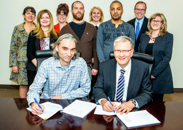 Concordia library staff sign a new contract with the university.