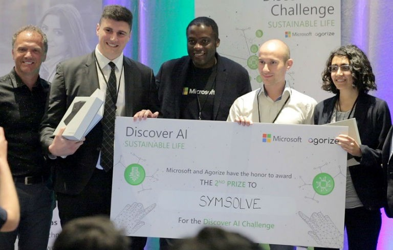 Marc Seaman (Microsoft Canada), Matthew Mannarino, Wemba Opota (Microsoft Canada), Paul Bugnon and Sara Amini at the Discover AI Challenge in Toronto, where the SymSolve team earned second place