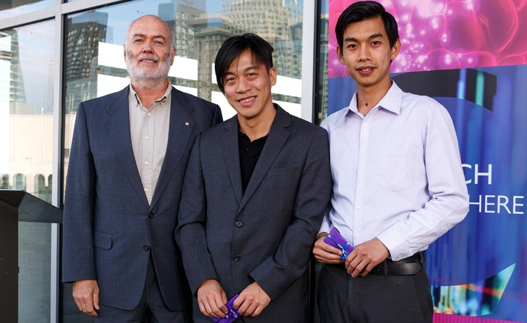 Petro-Canada Young Innovator Award recipients David Kwan (centre) and Tsz-Ho Kwok (right) with Christophe Guy.