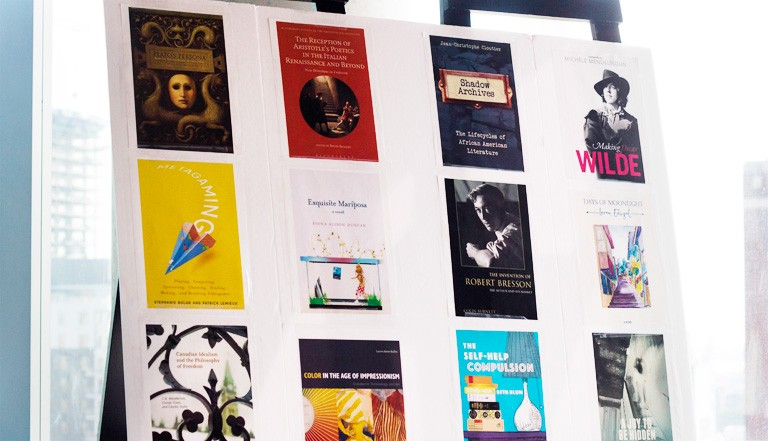A poster showing books written by Liberal Arts College alumni.