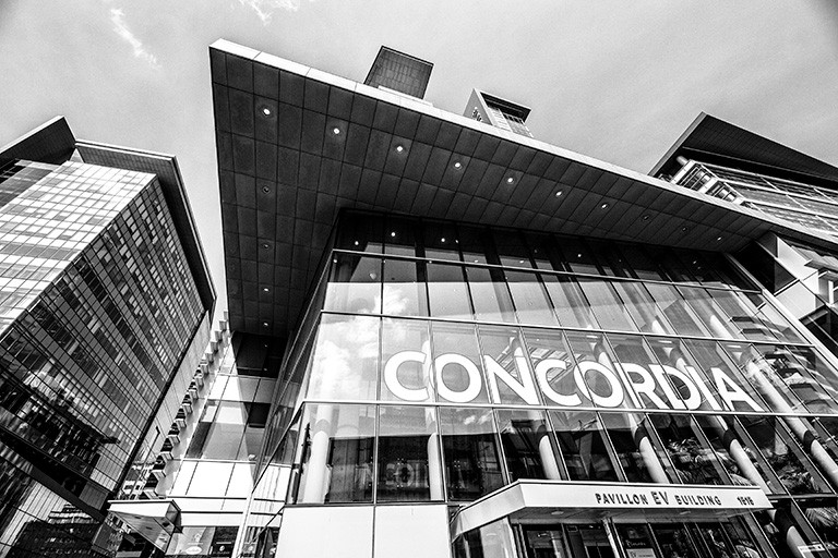 Black and white photograph of the front of the EV building on Concordia's downtown Campus.