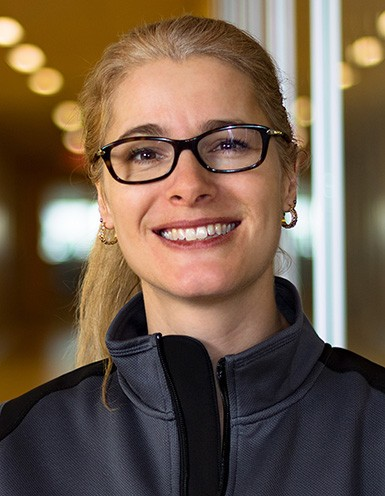 Young woman with blonde hair and glasses