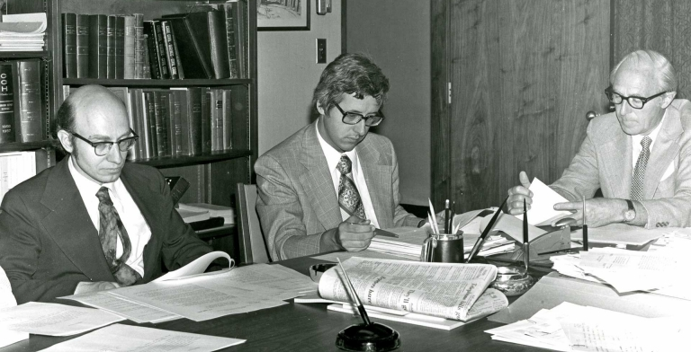 John O'Brien (left), Concordia's first rector and vice-chancellor, reviews documents during the final days of meetings with government officials to finalize the merger of Loyola College and Sir George Williams University to form Concordia. | Photo courtesy Records Management and Archives