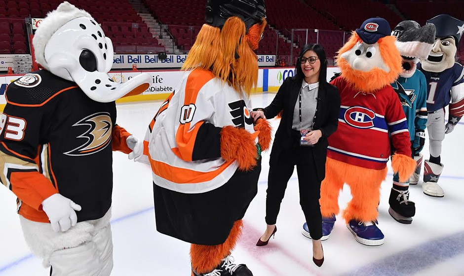 Cynthia Paquin-Lepage with NHL mascots