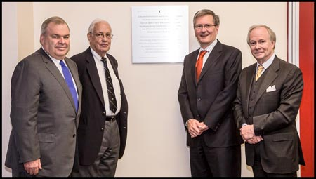 From left: J. Birks Bovaird, Evan Birks, Alan Shepard and Jonathan Birks unveil a plaque in the Webster Library on October 17 to honour the Birks family's contributions to Concordia.
