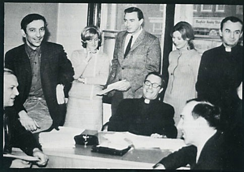 Father O'Brien (seated, centre) and members of Loyola College's Communication Arts program