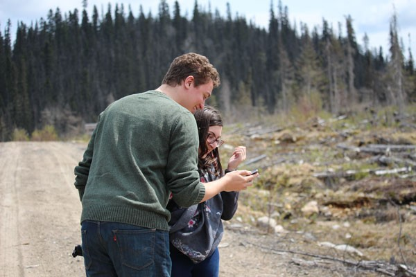 Concordia journalism students Gregory Todaro (left) and Casandra De Masi in a logged area north of Baie-Comeau, Que. | Photo credit: Michael Wrobel