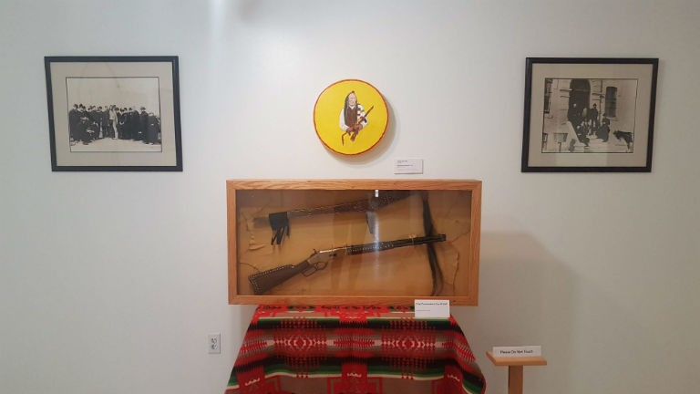 Chief Poundmaker's gun and staff.