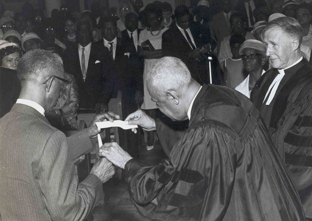 Reverend Charles Este was minister of the Union United Church for 45 years (1923-45). Here he is ceremonially burning the church's mortgage.