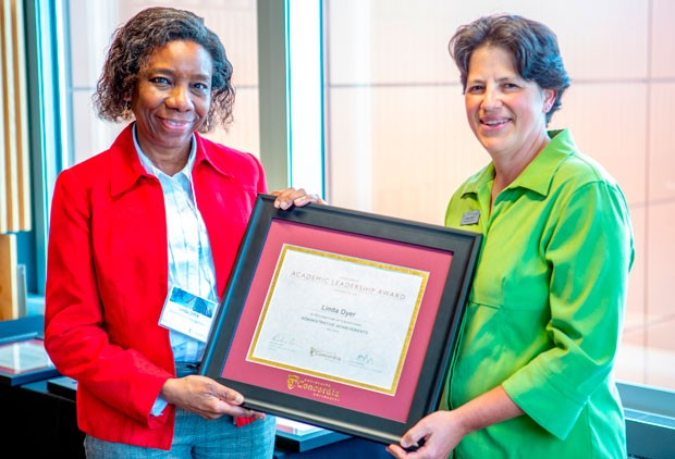 Academic Leadership Award winner Linda Dyer (left) with Nadia Hardy, vice-provost of Faculty Relations.