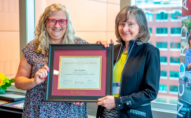 Graduate Mentoring Award winner Ann English (right) with Paula Wood-Adams, dean of Graduate Studies.