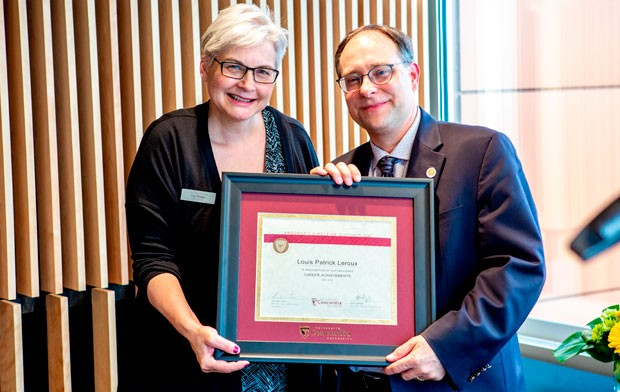 Provost's Circle of Distinction inductee Louis Patrick Leroux with Lisa Ostiguy.