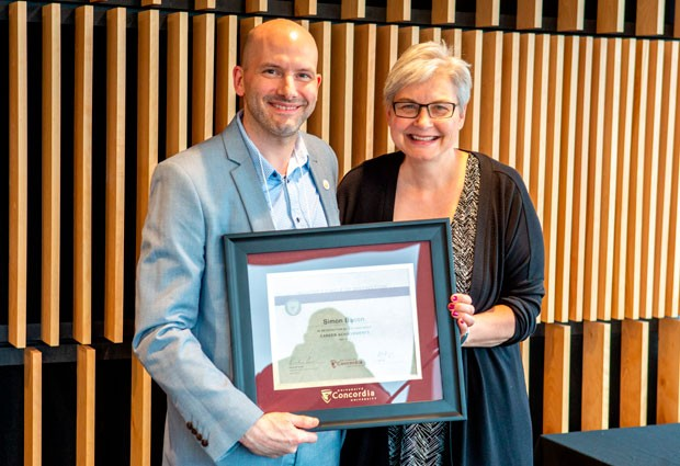 Provost's Circle of Distinction inductee Simon Bacon with Lisa Ostiguy, deputy provost.