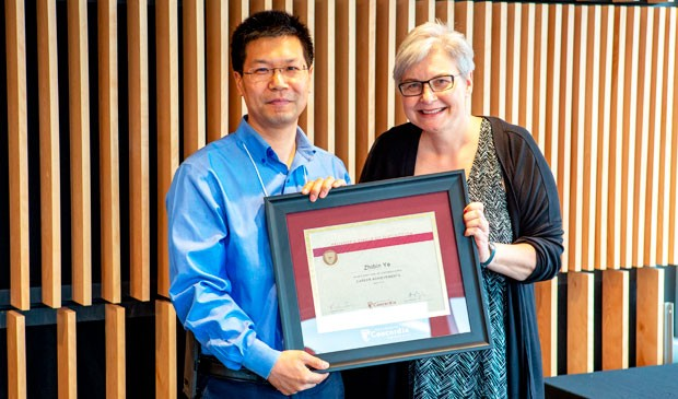 Provost's Circle of Distinction inductee Zhibin Ye with Lisa Ostiguy.
