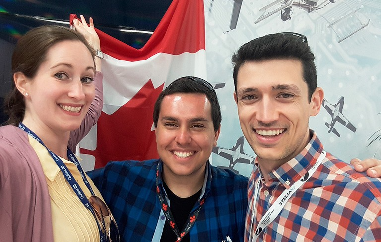 Andréa Cartile (left) and James Mariotti-Lapointe (right) with a friend from the Paris Air Show.