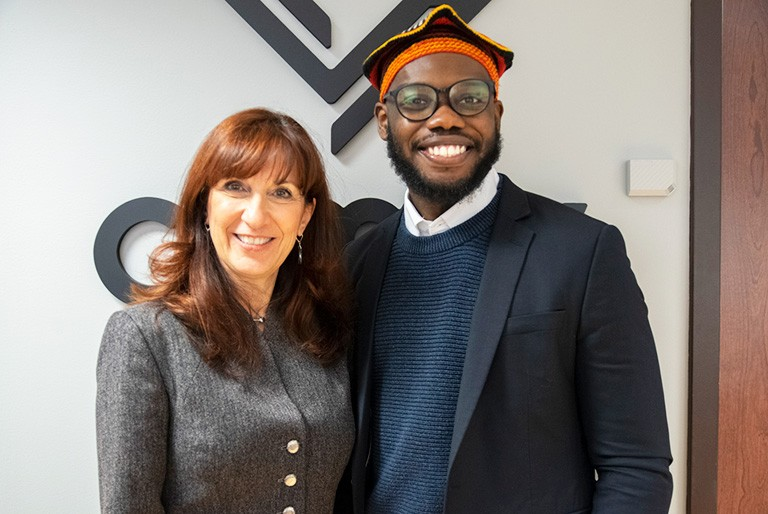 Lucia Pollice, CEO of CDMV, with JMSB student Maurice Ngwakum-Akisa